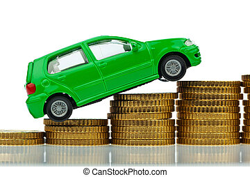 car and coins rising cost car - a model car standing on...