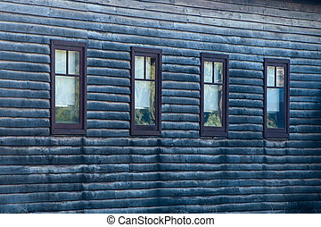 Four Sight - Four windows in grey weatherboard wall