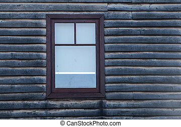 A Dirty Window - brown wood-framed window in grey wooden...
