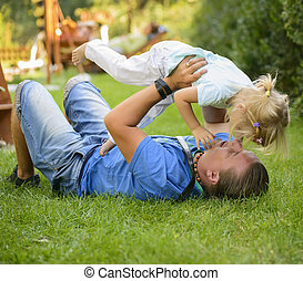 baby girl playing with dad - Little girl playing outdoor...