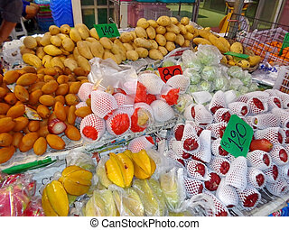 Market in the tropical fruits and vegetables