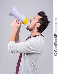 Gossip - Young man is making announcement over a megaphone...