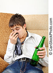Teenager in Alcohol Addiction - Drunken Teenager with Bottle...