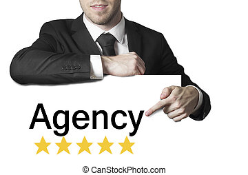 businessman pointing on sign agency isolated - businessman...