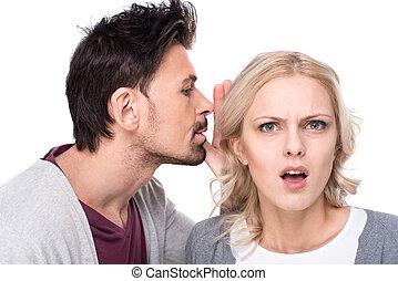 Gossip - Amazed woman is listening gossip in the ear from...