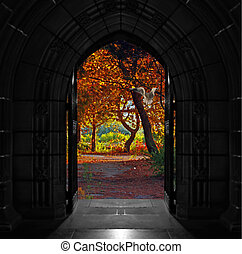 Old arched church doors opening out onto beautiful, colorful...
