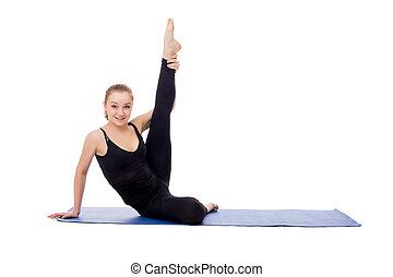 Lovely girl doing fitness exercises on mat