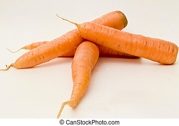 isolated object - The roots of carrots on a white...