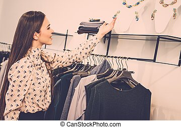 Young woman looking at jewellery in a showroom