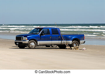 Pickup truck on the beach in southern Texas, USA
