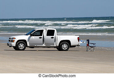 White pickup truck on the beach, southern Texas, USA