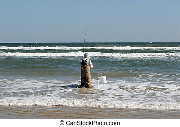 Fisherman on the beach, Padre Island, south Texas USA