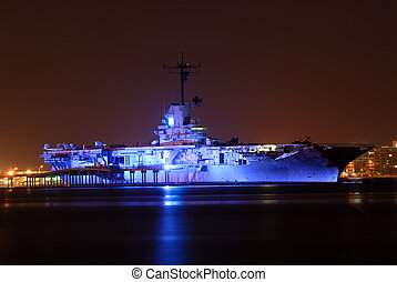 Aircraft Carrier USS Lexington illuminated at night, Corpus...