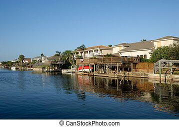Houses waterside on Padre Island, Southern Texas USA