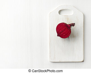 raw beetroot on wooden cutting board