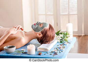 Woman with spa mask - Young woman with spa facial mask on...