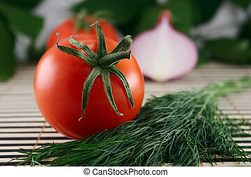 Tomato with fennel and an onions on a wooden napkin - Tomato...