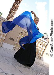 dancing with swirling veil - attractive blonde belly dancer...