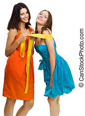 Two young women have fun,dressed in bright color...