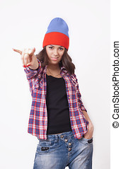 Cute hipster teenage girl with beanie hat posing looking at...