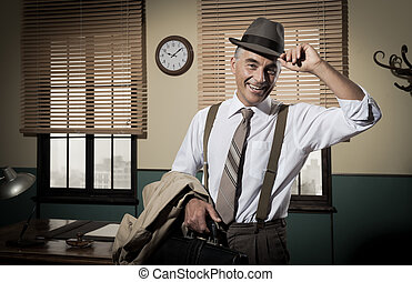 Smiling businessman going home - Smiling businessman leaving...