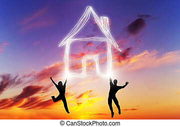 A couple jump and make a house symbol of light. New home,...