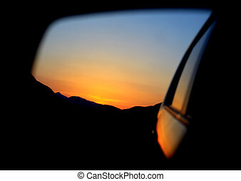 Car rearview mirror & sunset