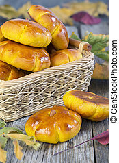 Basket with pumpkin buns - Basket with pumpkin buns and...