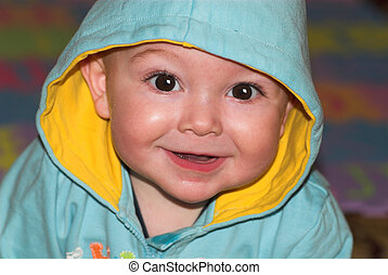 Cute baby portrait - Cute tothless baby with hood on his...