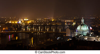 View on Prague bridges and Vltava river at night