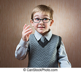Portrait of cute little boy in tie and glasses