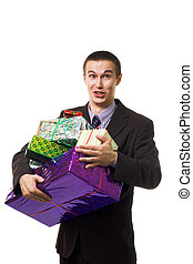 Young crazy man with many presents with grimace on his...
