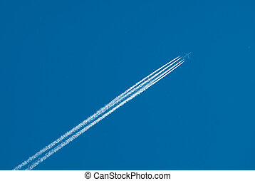 Flying plane and inversion trace from engines - Airplane...