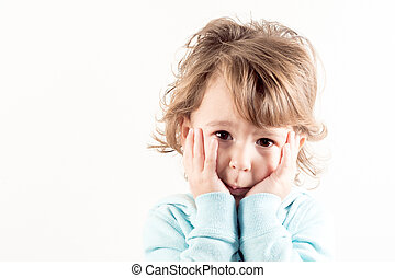 Worried child - Portrait of worried child on white...