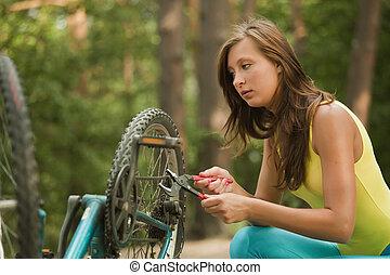 woman repairs the bike