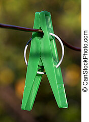 Clothes-peg - Plastic clothes-beg on the metal wire over...