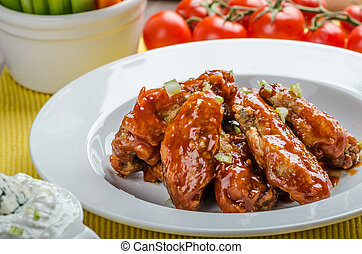 Chicken hot wings, homemade blue cheese sauce and fresh...