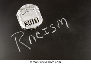 Police Profiling - The word RACISM on a chalkboard with a...