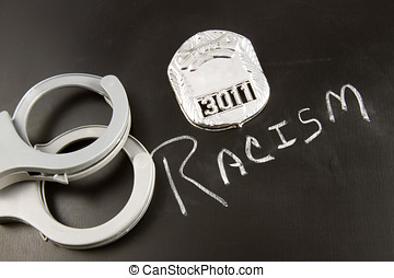 Racism in Law Enforcement - The word RACISM on a chalkboard...