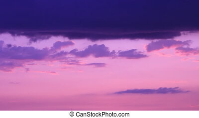 Purple evening sky - Dark clouds silhouettes at purple...