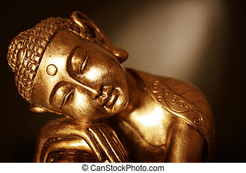 Close up of Buddha statue - A Buddha statue resting, in...