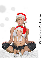 family clothing for fitness and Santa hats sitting on snow
