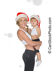 Family clothing for fitness and Christmas hats under snow