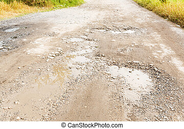 Bumpy road - Close up bumpy stone road with water in...
