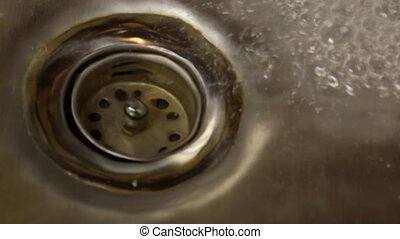 Clean water flowing down the drain - Tap water from kitchen...