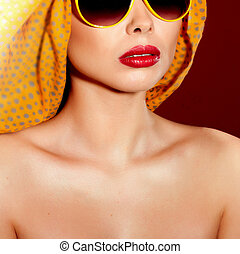 Beautiful woman in sunglasses and shawl - Portrait of...