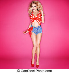Flirty Woman Wearing Short Jean Shorts - Flirty Blond Woman...