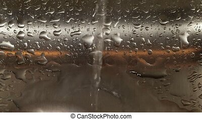 Water dripping from faucet - Water dripping in stainless...