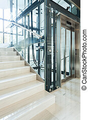 Elevator in the business office - Glass elevator in the...