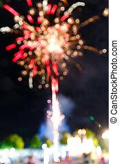 Firework in night fun fair carnival - Colorful blurry...